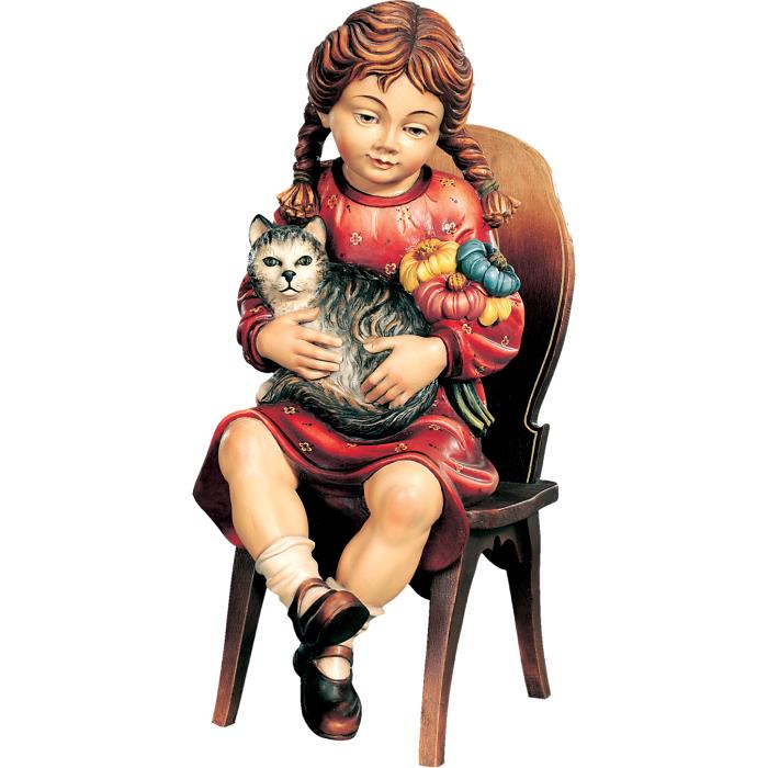 Sitting girl with cat on chair