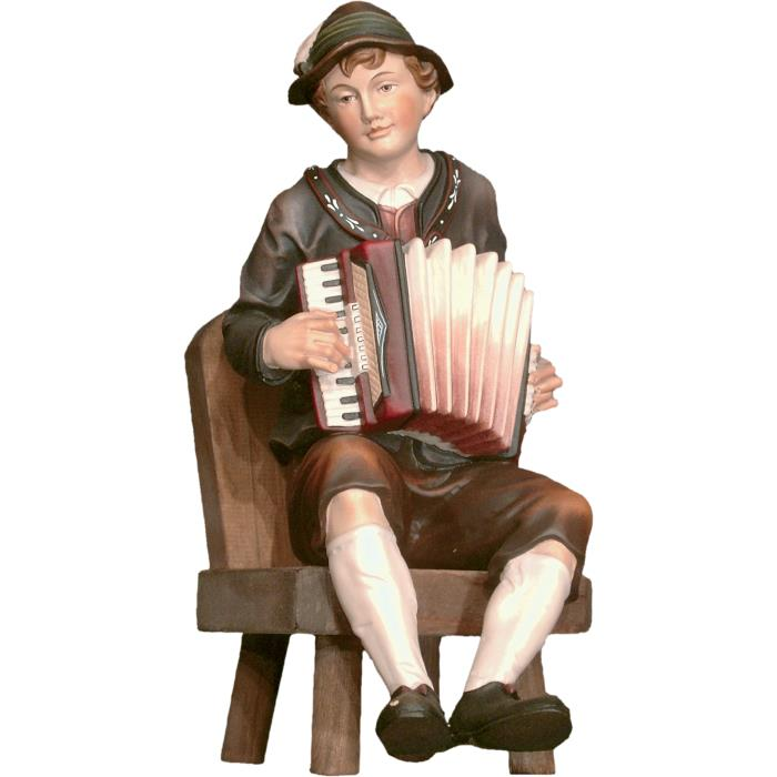 Accordion player seated on chair