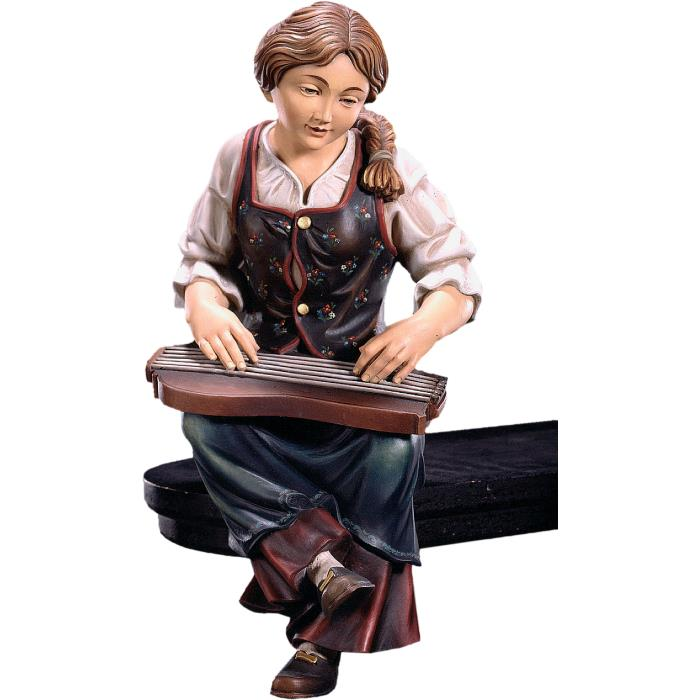 Zither player seated