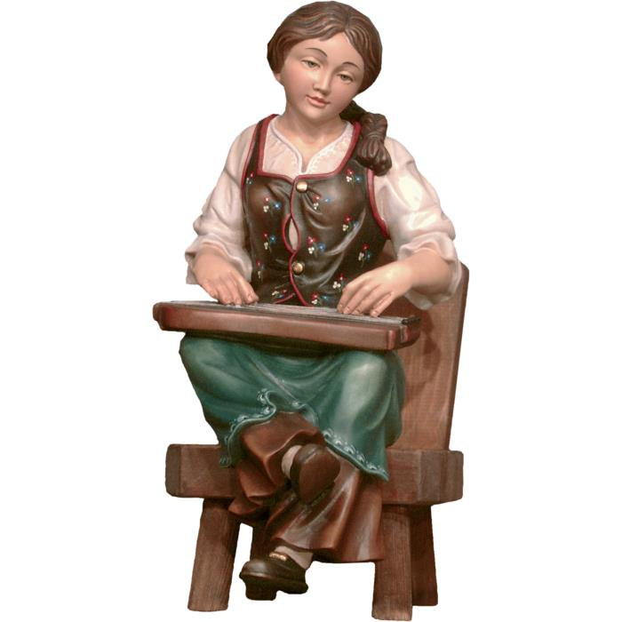 Zither player seated on chair