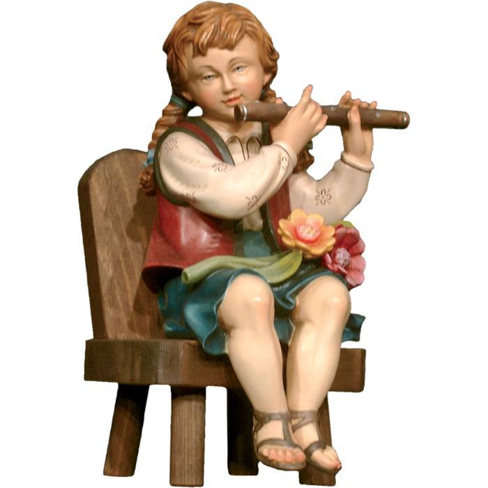 Flute player sitting on chair