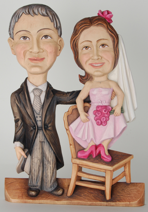 Caricature of a bridal couple colored wooden bridal couple