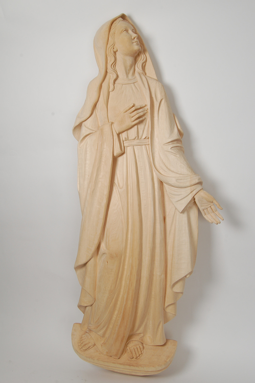 Bas-relief of Our Lady of Sorrows Wooden sculpture representing Our Lady of Sorrows before the treatment with mordant (stain)