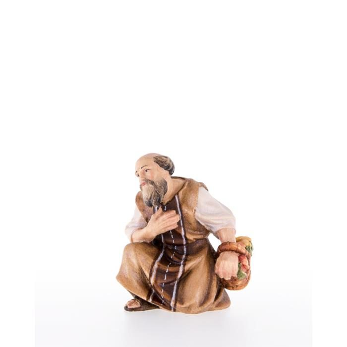 Shepherd kneeling with basket