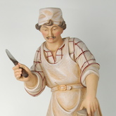 Sculpture of basswood painted with oil colors representing a cheese-maker