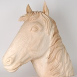 Wooden sculpture made by Demi Art of a horse's head